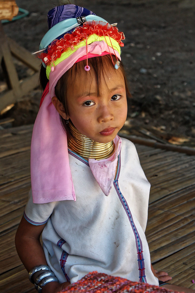 Paduang girl, Mae Sa Valley. Some Paduang girls begin wearing the controversial metal neck coils as early as 5 or 6 years old. The coils are replaced with longer ones as the collar bone is pressed down and the rib cage depressed over time. Though some Paduang girls and women choose not to wear the coils, it seems that many are too young to be able to make a choice before they begin wearing them.