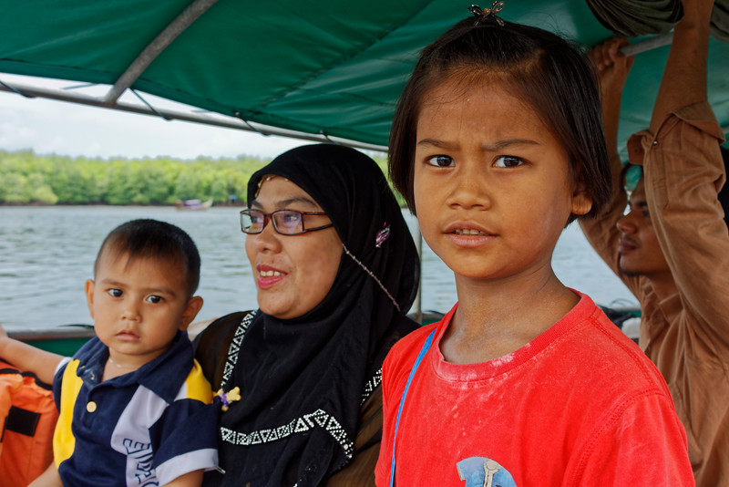 Muslim girl with her mother and brother on a longtail boat at Krabi, southern Thailand. The father was the skipper.