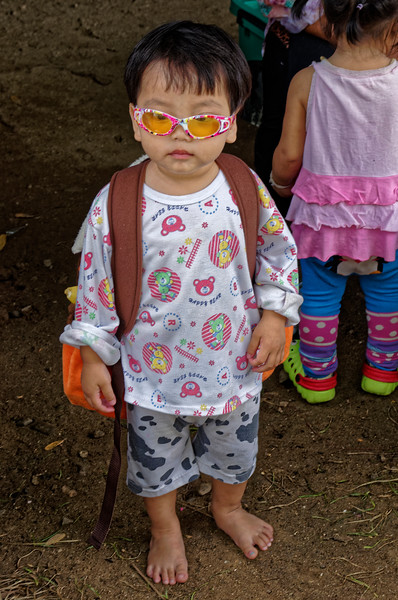 What the fashionably dressed young man is wearing these days in Santichon, northern Thailand