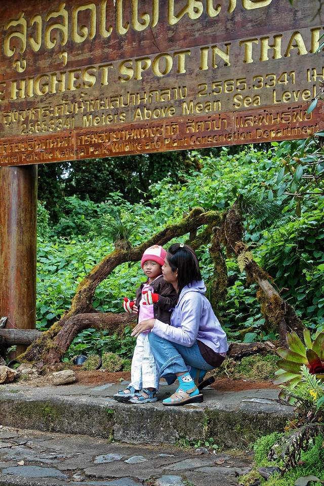 "Mother and child at ""The Highest Spot in Thailand,"" atop Doi Inthanon, in the north"