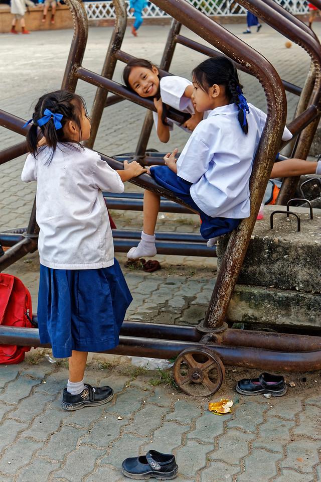 Schoolgirls at a playground adjoining Wat Ket Karam, Chiang Mai
