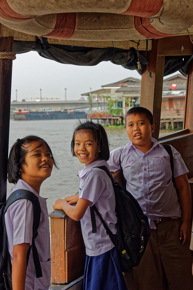 Schoolchildren on a commuter ferry on the Chao Phraya River in Bangkok, amused to discover their picture being taken. Getting off the boat after it docked, the girl in the middle joked to me, 'See you tomorrow!'