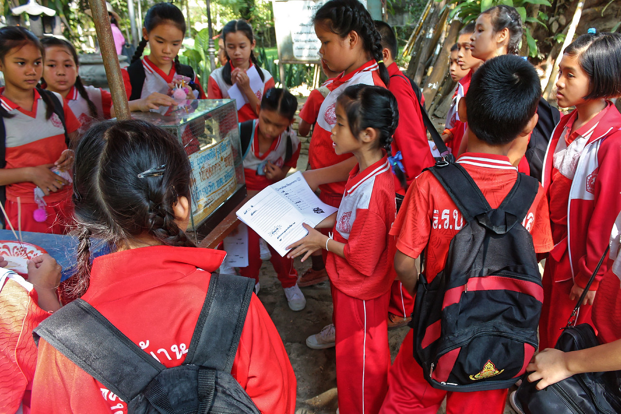 School children studying their heritage at Wat Changkam, near the city of Chiang Mai