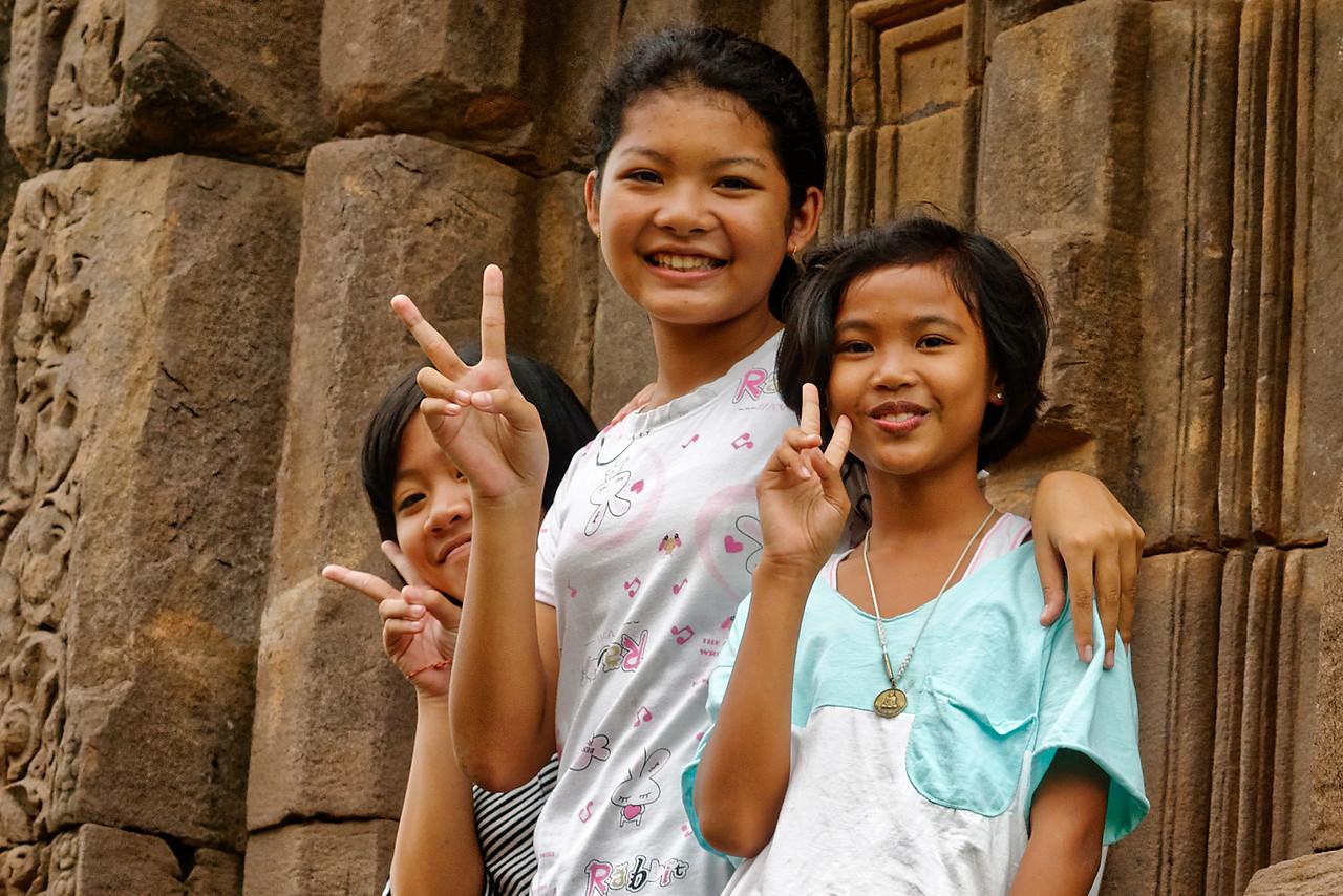 Three friendly fellow visitors at the 11th-century Khmer temple Prasat Sa Kamphaeng Yai, Sisaket