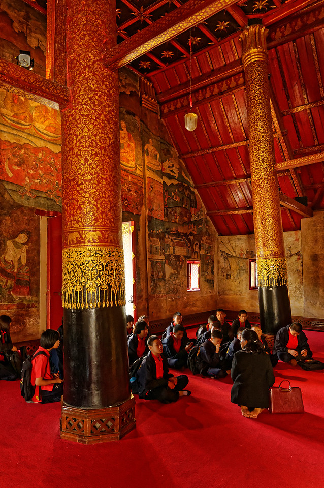 Primary school students with their teacher on a class tour to Wat Phumin in Nan, northern Thailand