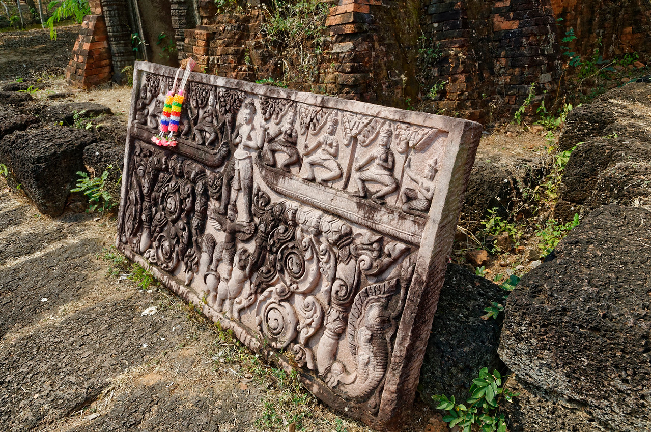 Replica of a lintel found at Prasat Prang Ku. The central figure is Vishnu standing atop the outstretched arms and wings of the part-bird part-human Garuda, Vishnu's traditional mount. One of the three principal Hindu deities, Vishnu is often depicted, as here, with four arms.
