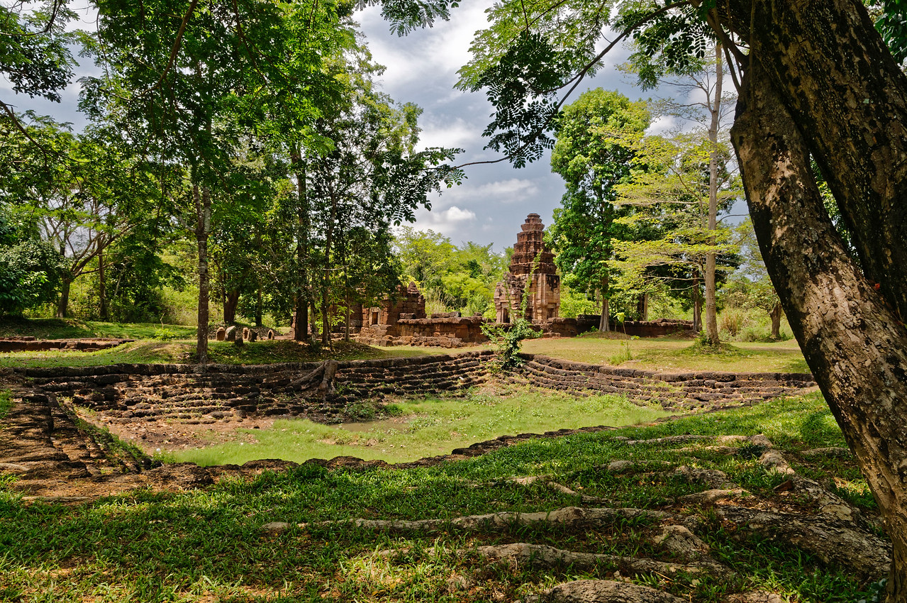 Near Prasat Ta Muean is Prasat Ta Muean Toht, also built during the reign of Jayavarman VII. The laterite-lined, dug-out area seen in the foreground here would originally have held water, possibly used for ritual purposes.