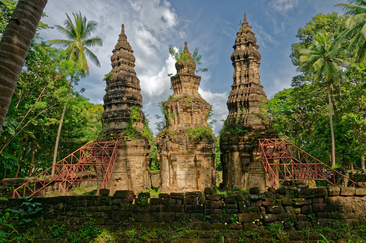 The towers at Prasat Ban Prasat, seen here from in back of the temple, are supported today with metal scaffolding.