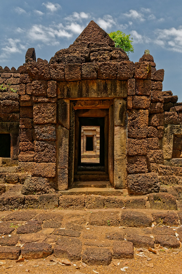 At Prasat Ta Muean Toht: a view through the <i>gopura,</i> or entry pavilion, to the central tower