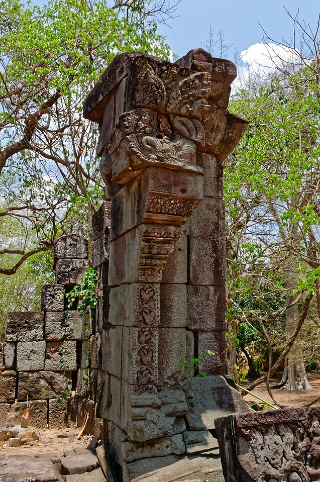 The colonettes at the entrance to Ta Leng were decorated with bird and floral designs and topped by multi-headed <i>naga</i>—mythical benevolent, serpentlike guardians. The birds are <i>hamsa,</i> sacred geese associated with Brahma and with fertility.