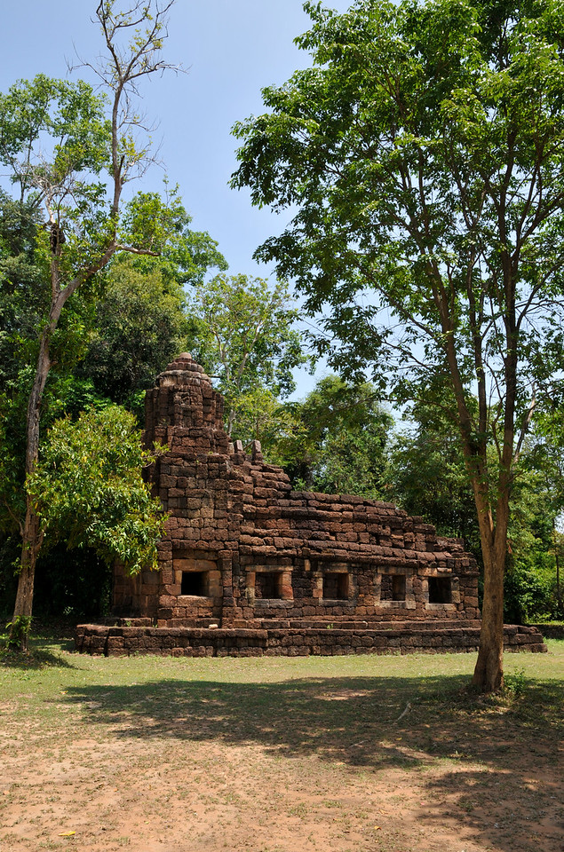 During the reign of Jayavarman VII, king of Cambodia from approximately 1181 to 1215 AD, many ambitious building projects were carried out, of which Prasat Ta Muean, seen here, and the neighboring Prasat Ta Muean Toht and nearby Prasat Ta Muean Thom were a part. Prasat Ta Muean consisted of a single laterite and sandstone building. Its purpose remains obscure, but it likely served as the chapel of a <i>dharmasala</i> or rest station for pilgrims traveling on the royal road between Angkor and Prasat Hin Phimai in today's Nakhon Ratchasima Province.