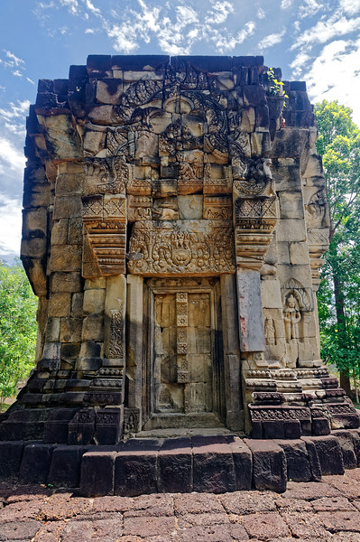 As at most Khmer temples, only the east side of the central tower provided an opening to the sacred space, with false doorways on the other three sides. The lintel on the south side, seen here, depicts the god Indra on Erawan, or Airavata, his traditional multi-headed elephant mount. The iconography on the pediment is largely unreadable.