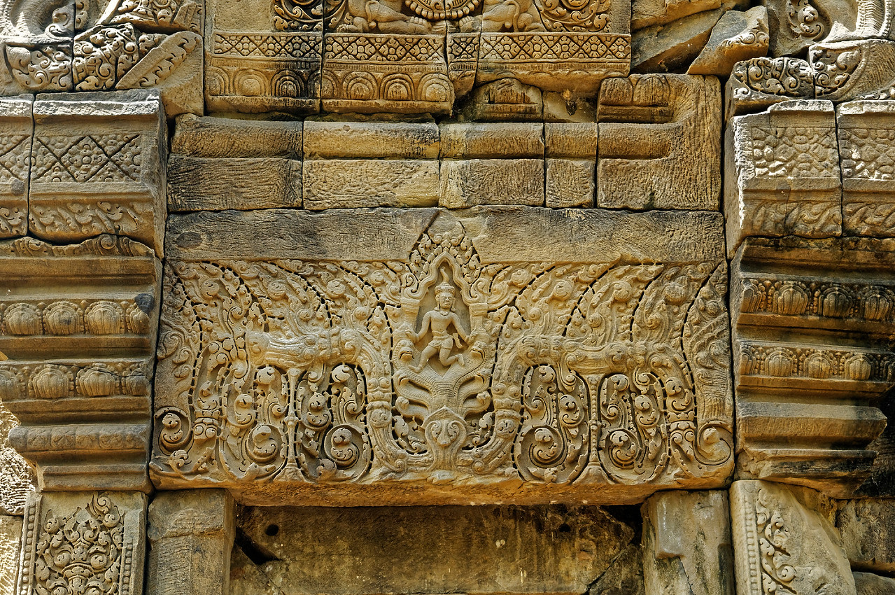 The lintel on the north side of the tower depicts Krishna doing battle with the multi-headed serpentlike <i>naga</i> Kaliya.