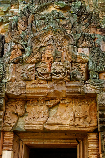 Much of the imagery decorating the temple derives from the Hindu classic <i>Ramayana.</i> In this scene over the west entry to the central tower, a replica of the tower serves as the chariot that carries the abducted Sita, Rama's wife, off to the evil Ravana. On the lintel, Rama and Lakshmana are wrapped in the coils of a serpentlike arrow, captives of Indrajit, Ravana's son.