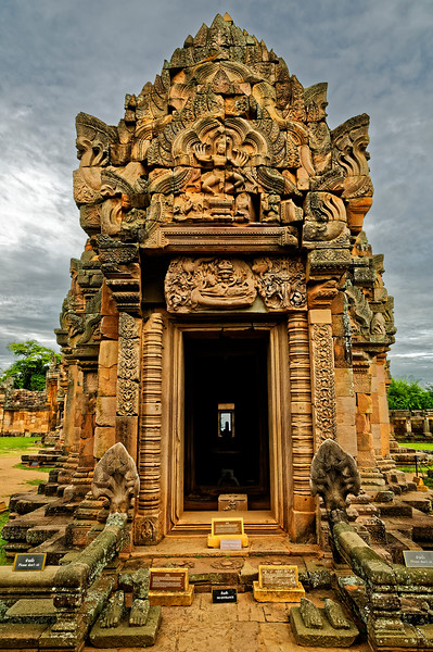 The eastern entrance of the <i>mandapa,</i> the antechamber leading to the main shrine. The carving on the pediment depicts the ten-armed dancing Shiva, Shiva Nataraja, Lord of the Cosmic Dance. As god of both creation and destruction he has the awesome ability to create, sustain, and withdraw the universe. Here he is seen dancing on an altar on Kailasa, his mountain home.