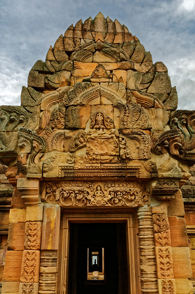 The main entrance to the inner sanctuary is through this opening in the <i>gopura</i> or entry pavilion. The meditating Shiva is on the pediment above, Indra on the lintel below. In the far distance is the silhouette of a Shiva linga in the most sacred chamber of the temple.