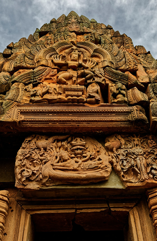 On the lintel, Vishnu reclines on Ananta, mythical king of the <i>naga,</i> who is floating on the Sea of Milk, the source of Amrita, the nectar of immortality. Lakshmi, Vishnu's consort, is at his feet. Rising from Vishnu's navel is a lotus flower, on which Brahma is seated. Brahma will bring to fruition Vishnu's dream of a new cosmic order, recreating the universe as part of an endless cycle of destruction and regeneration.