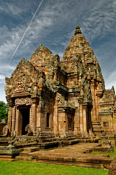 An incongruous juxtaposition of 21st-century jet vapor trail and the ancient Khmer sanctuary