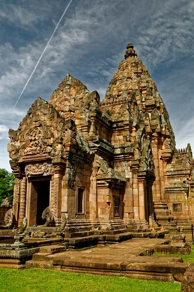An incongruous juxtaposition of 21st-century jet vapor trail and the ancient Khmer sanctuary