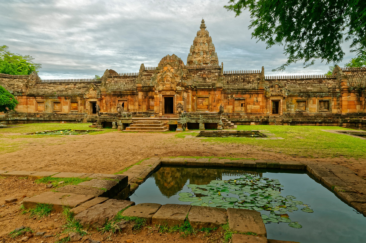 In accordance with Khmer temple tradition, the main entrance to Phanom Rung faces east. Four small pools located at the corners of the terrace symbolize the cosmic ocean on which the universe rests.