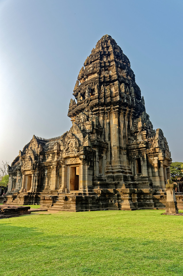 At Phimai, several modifications to the traditional design of the Khmer temple's central tower led to a more unified appearance while at the same time lending it more of an upward-flowing profile. The resulting structure, termed a <i>prang,</i> attained the look of a unified whole rather than that of a superstructure sitting atop a base, typical of earlier Khmer designs. Such innovations affected the design of later Khmer sanctuaries—most notably that of Angkor Wat, built soon after Phimai.
