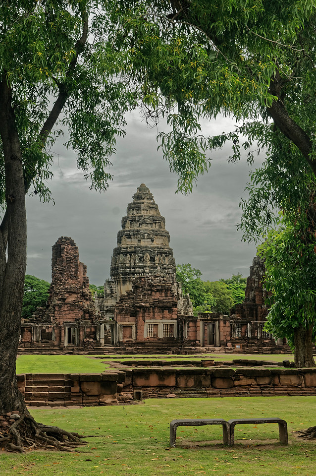 From within the outer enclosing gallery, a view of the central tower and subsidiary towers, which are behind a second, inner gallery. The temple was oriented in an unusual direction, facing not east, as was traditional, but southeast, aligned roughly on the ancient royal road from Angkor.