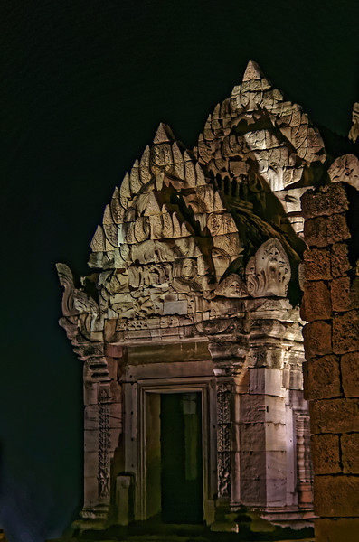 The <i>mandapa</i> at night, with a portion of the laterite wall of Prang Brahmadat at right