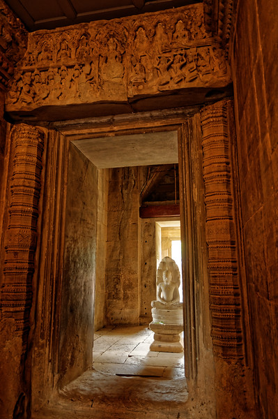 Interior carvings at Phimai include those with Tantric Buddhist themes. The bas relief on the lintel over the main entrance to the central sanctuary depicts the Buddha meditating under the protective hood of a <i>naga.</i> In the sacred chamber itself, a Buddha sheltered by a <i>naga</i> was the temple's principal object of worship. The present image is not the original.