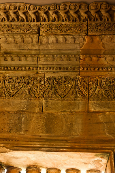 Along a corridor inside the central <i>prang,</i> carved <i>singh,</i> lions, seem to be engaged in holding up the ceiling.