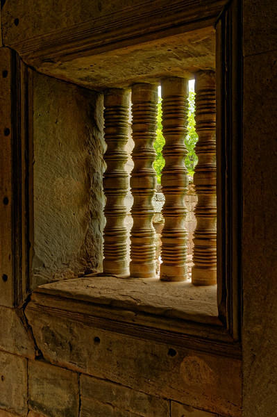 Stone balustrades in window openings were among the many architectural motifs whose origins were in India.
