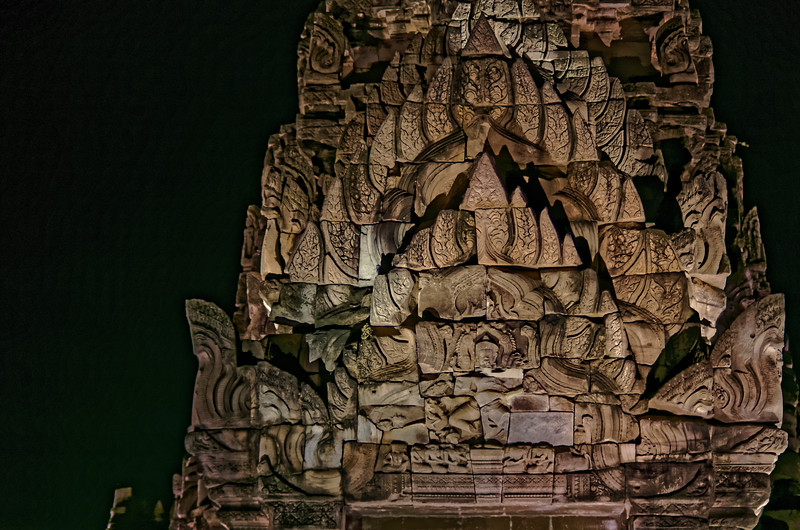 The pediment over the main entry to the <i>mandapa</i> at night