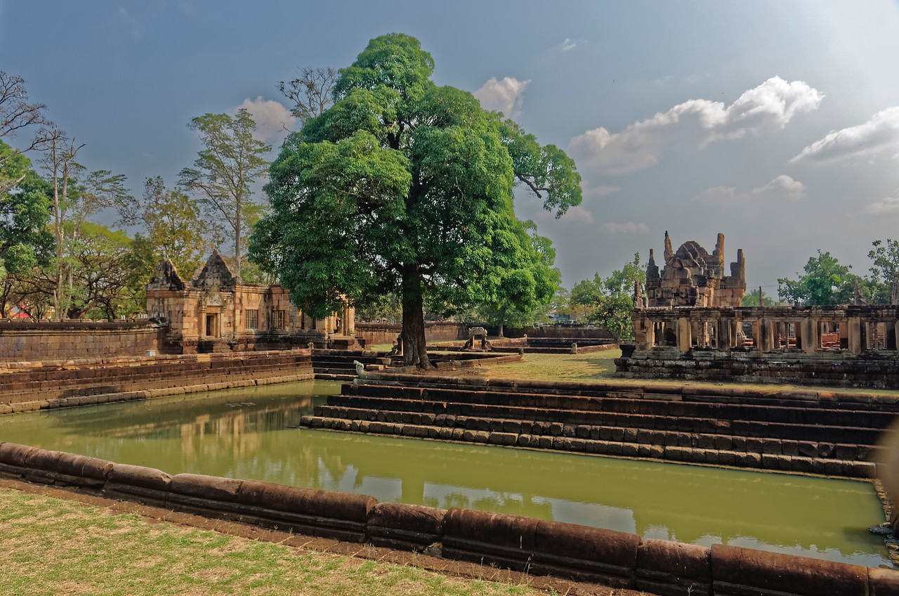 Within the outer enclosure at Muang Tham, four L-shaped ponds, almost certainly meant to represent the cosmic ocean on which the universe rests, surround an inner gallery and the main sanctuary. The ponds' large size is unusual, creating the appearance of an enclosing moat intersected by broad causeways.