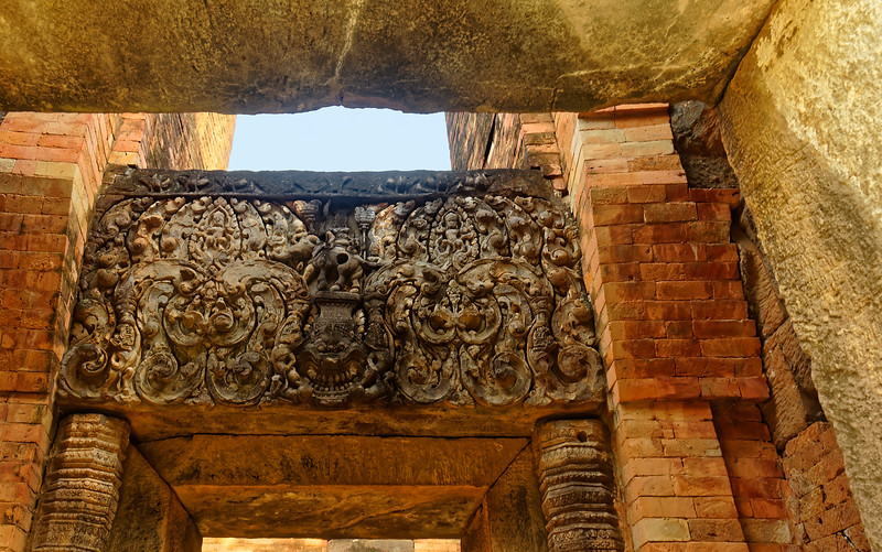 Within the central sanctuary, this lintel depicts the god Indra (whose head has been lost) on his traditional mount, the elephant Erawan. They are on a platform atop the fierce face of a <i>kala</i> demon, a threshold guardian.