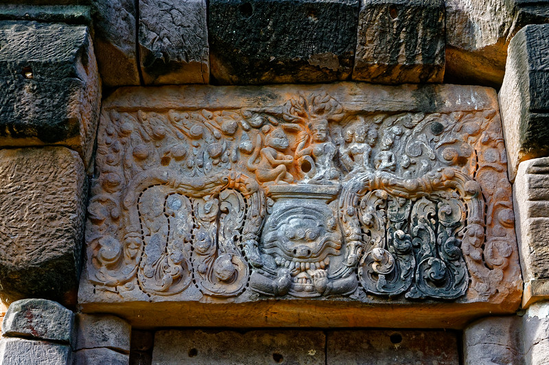 The lintel on the central tower's south side depicts a scene from the Hindu classic <i>Ramayana.</i> The monkey god Hanuman, ally of Rama, has come to the island of Lanka to tell Rama's wife, Sita, that Rama is on his way to rescue her from her abductor, the evil Ravana.