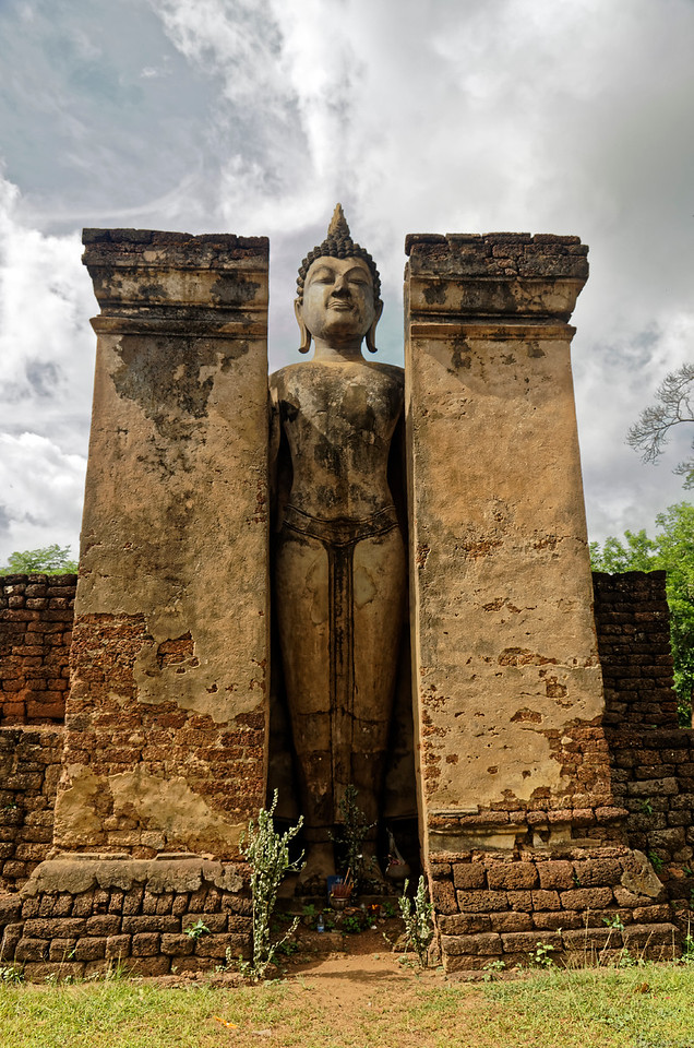 Also behind the central sanctuary is this enormous standing Buddha in <i>abhaya mudra.</i>