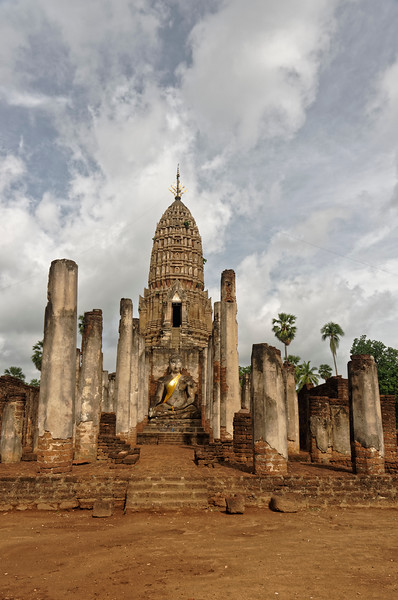 The temple's principal Buddha image sits in <i>bhumisparsa mudra</i> before the central tower.