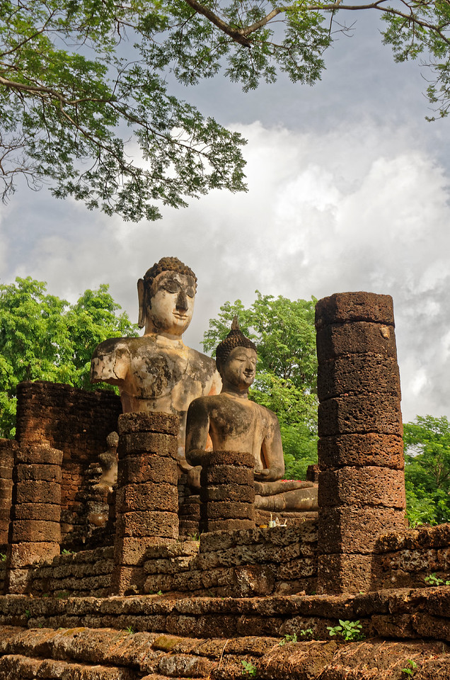 Two seated Buddha figures in the ruins of a temple structure in back of the central sanctuary