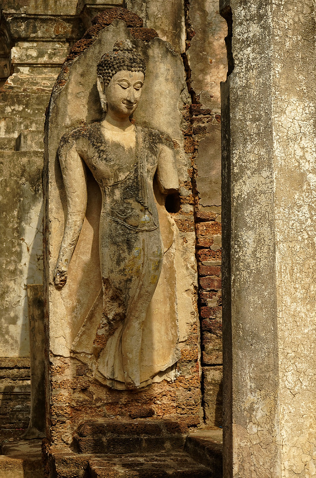 At the front of the central tower is this sculpture of a Sukhothai-style Walking Buddha.