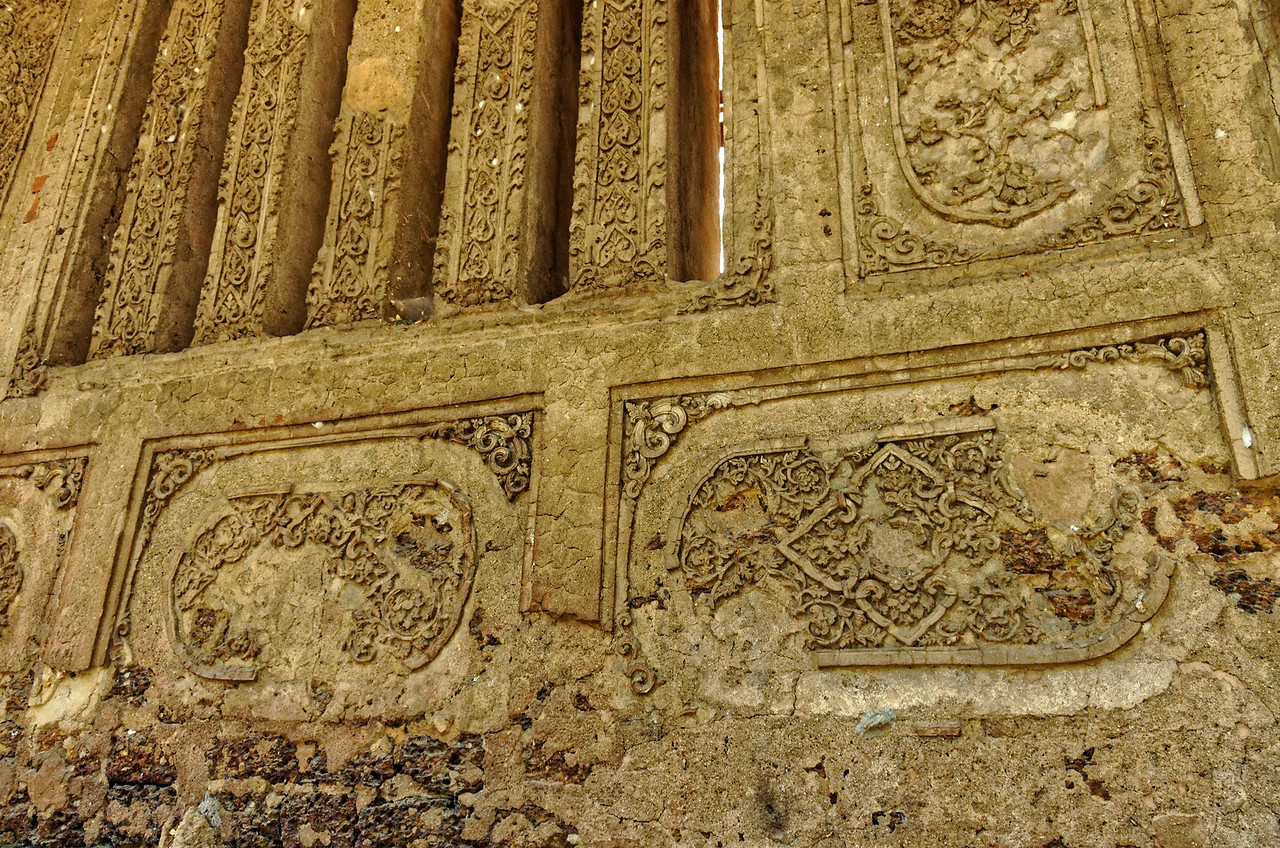 Stucco reliefs on the wall of the <i>viharn,</i> or assembly hall, at Wat Nong Phaya