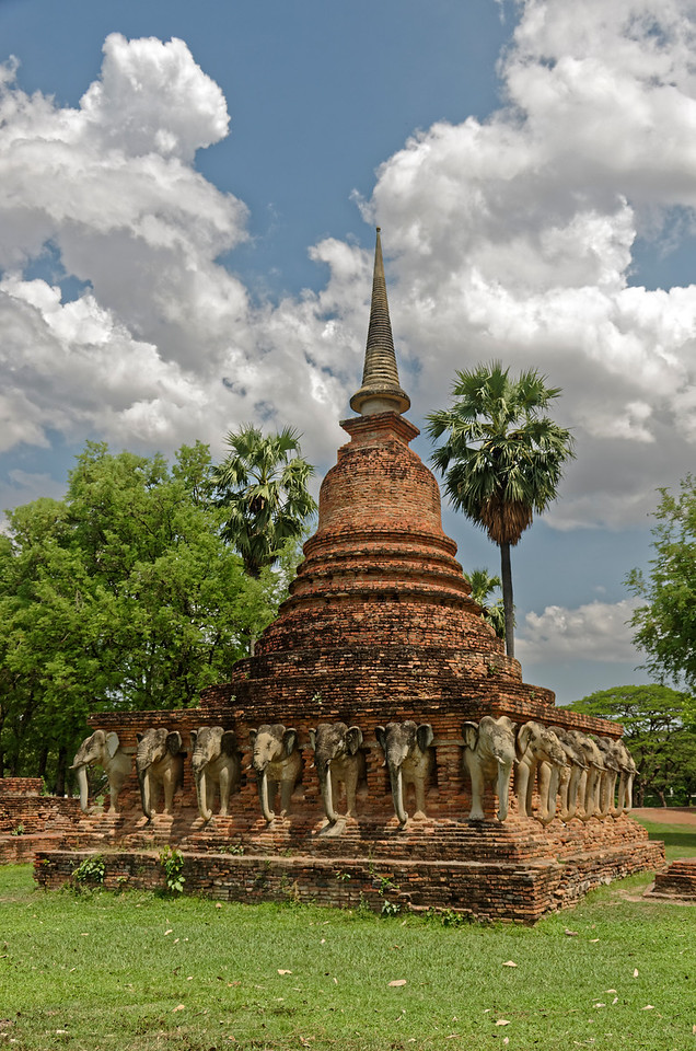 The <i>chedi,</i> or stupa, at Wat Sorasak. Both its bell-shaped relic chamber and the encircling elephants emerging from the base are derived from <i>chedi</i> on Sri Lanka.