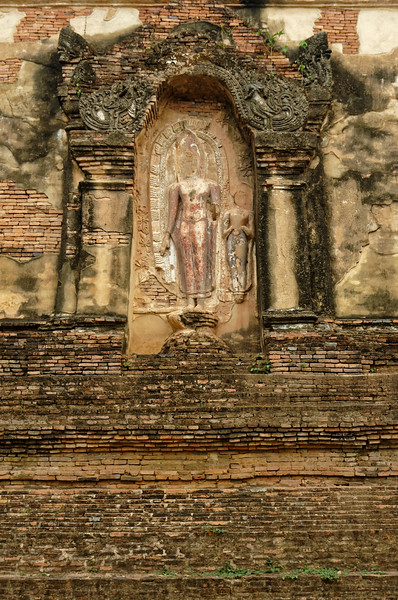 The three relief carvings on the exterior walls of the <i>mondop</i> at Wat Traphang Thong Lang depicted three incidents from the life of the Buddha, including this of him preaching.