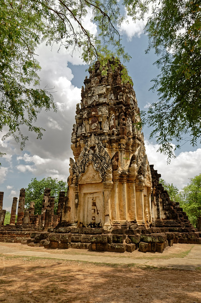 Wat Phra Phai Luang, built by Khmer King Jayavarman VII, dates from the late 12th or early 13th century. It was sited outside the walled center of Sukhothai, about a mile to the north.