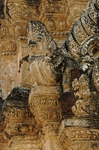 Carved stucco ornamentation on the tower at Wat Phra Phai Luang