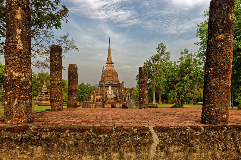 Looking across the raised platform that was the base of the <i>ubosot,</i> or ordination hall, towards the <i>viharn,</i> or assembly hall, and the main stupa at Wat Sa Si