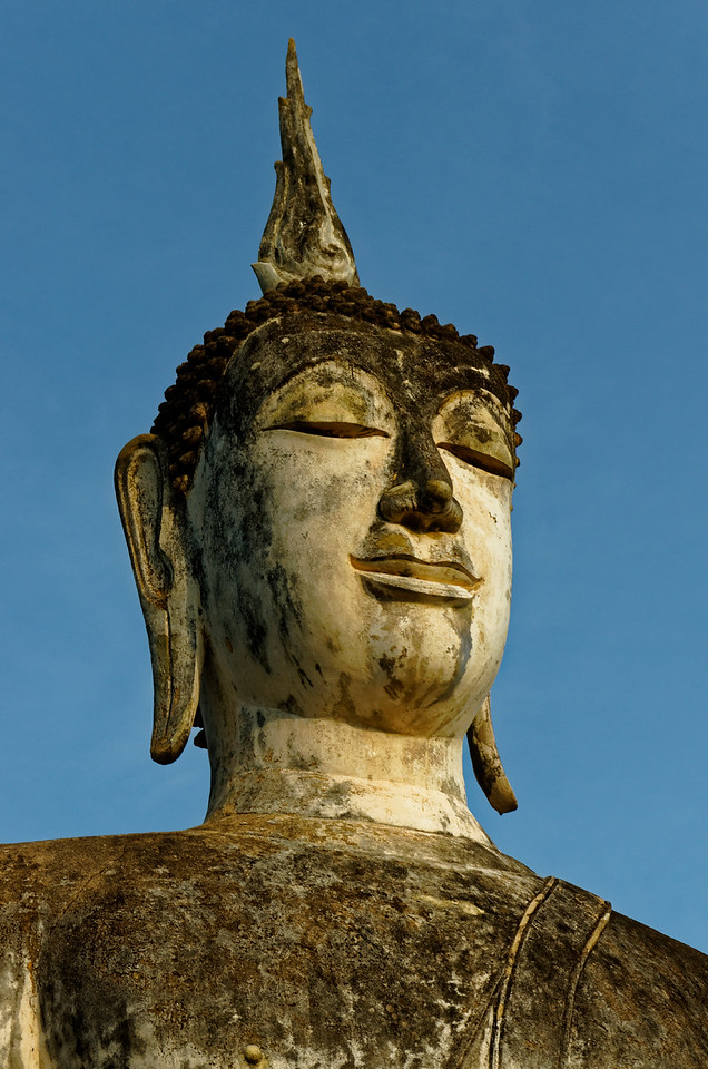 Despite its aged condition, the Buddha's visage is remarkably engaging.