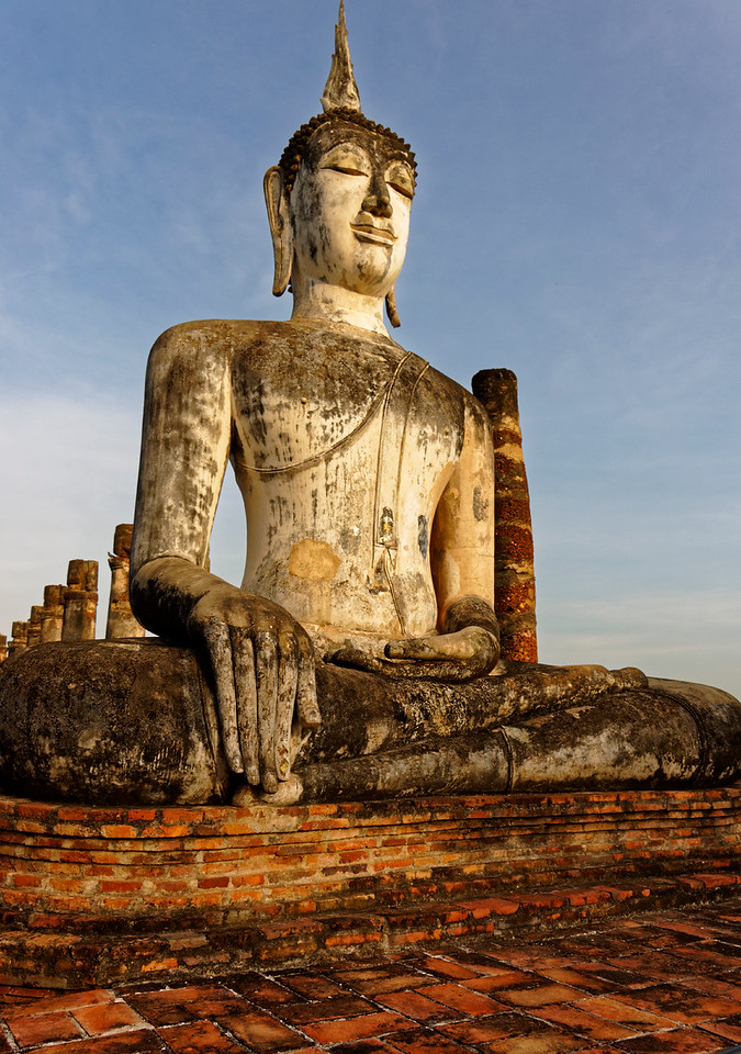This Sukhothai-style Buddha greets visitors today among the ruins of Wat Mahathat's main <i>viharn,</i> or assembly hall.
