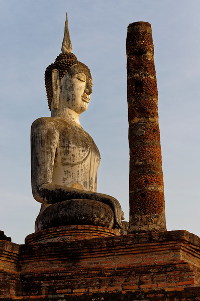Another look at the Buddha that dominates the view as one approaches the temple from the eastern entryway. The <i>bhumisparsa mudra,</i> known in English as 'Calling the Earth to Witness' or the 'Victory over Mara' mudra, symbolizes the moment of the Buddha's enlightenment, when all earthly delusions and desires fell away.