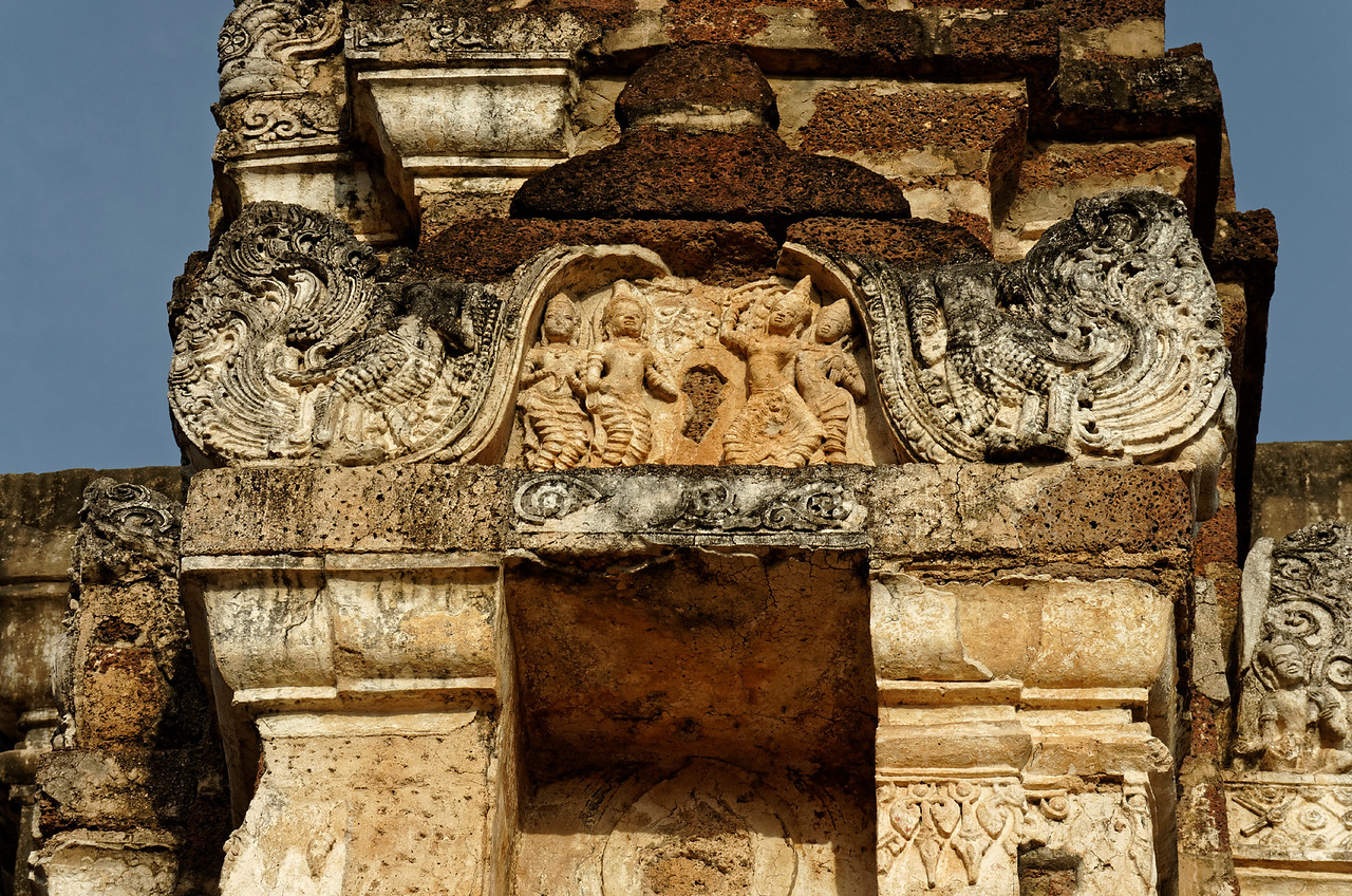 This detail from the pediment of one of the smaller <i>chedi,</i> or stupas, that surround the central sanctuary shows a scene from the birth of the Buddha, with the Buddha's mother surrounded by attendants. She stands, holding the branch of a tree, to give birth.