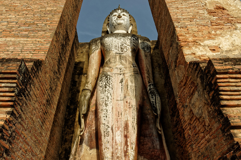 This enormous standing Buddha, in an open enclosure called a <i>mondop,</i>  is one of two. They appear on either side of the central sanctuary.