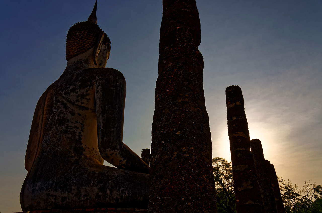 The temple at dawn. The Buddha image is in <i>bhumisparsa mudra,</i> a pose signifying the overcoming of all worldly desires and delusions, the point at which the Buddha attained enlightenment.